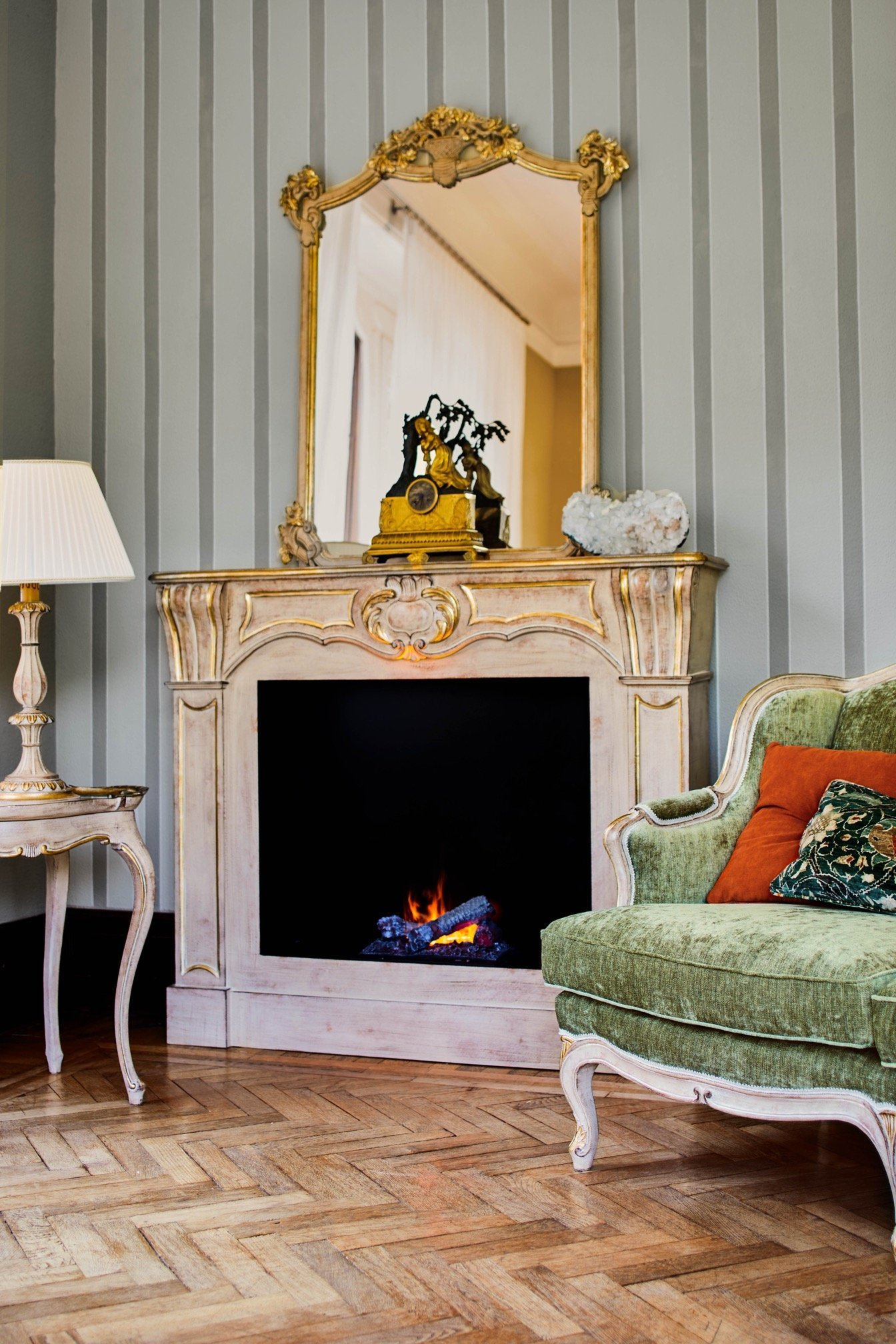 fireplace with large mirror