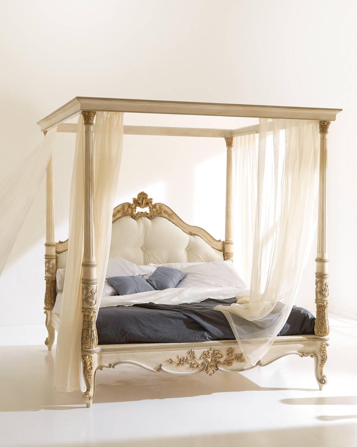four poster bed with white and ash-coloured canopy